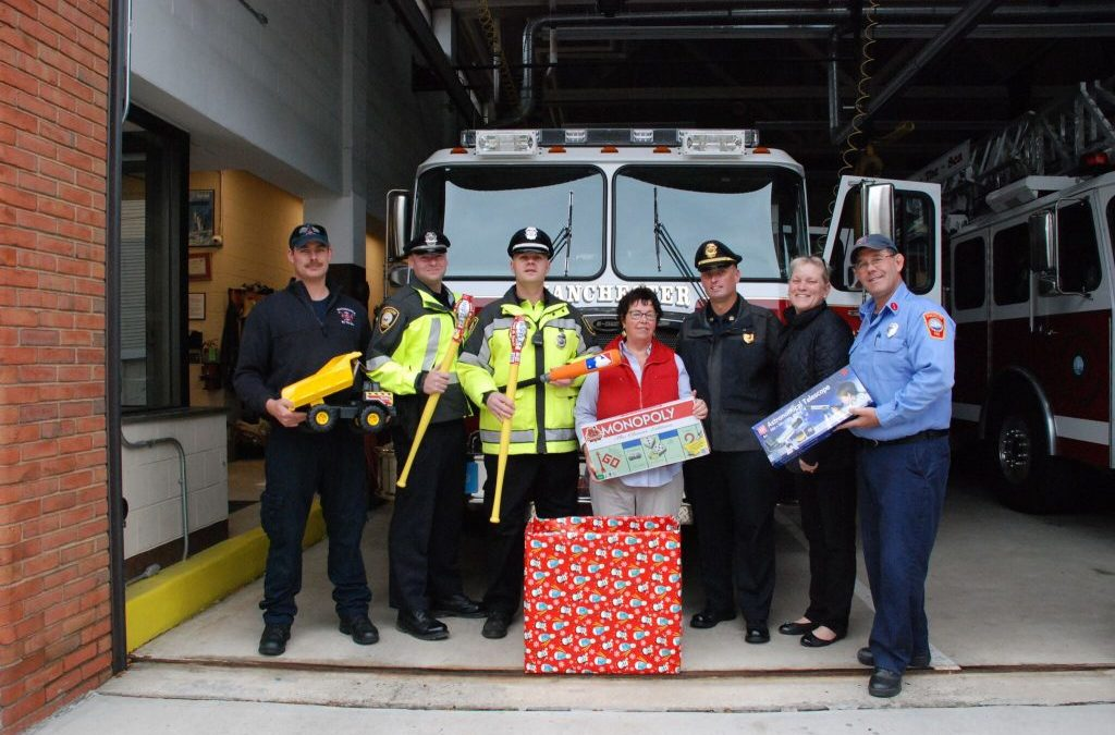 Manchester Firefighters and Police Organize Toy Drive for Wellspring House